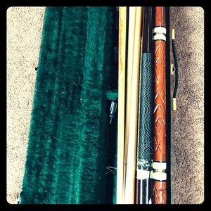 Pool sticks and a Mcdermott leather case